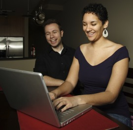 two people using computer at home